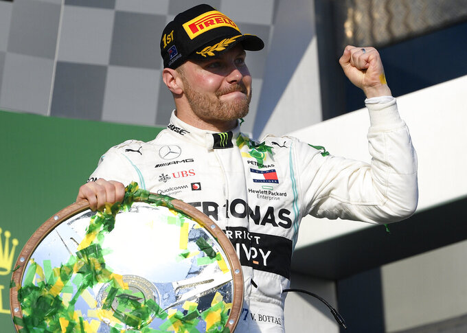 Mercedes driver Valtteri Bottas of Finland celebrates after winning the Australian Formula 1 Grand Prix in Melbourne, Australia, Sunday, March 17, 2019. Bottas won ahead of teammate Lewis Hamilton of Britain while Red Bull driver Max Verstappen of the Netherlands placed third. (AP Photo/Andy Brownbill)