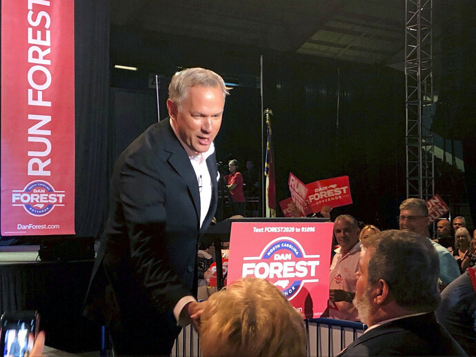 North Carolina Lt. Gov. Dan Forest shakes hands with supporters during his gubernatorial campaign kickoff rally in Winston-Salem, N.C., on Saturday, Aug. 17, 2019. Forest, a Republican, told supporters he would pursue a vision for the state based on economic and educational opportunity, human dignity and societal unity if he's elected governor next year. (AP Photo/Gary Robertson)