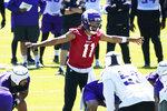 MinnesotaV ikings quarterback Kellen Mond runs a play during NFL football minicamp practice Tuesday, June 15, 2021, in Eagan, Minn. (AP Photo/Jim Mone)