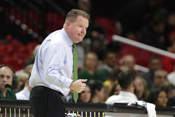 George Mason coach Dave Paulsen talks to his team against during the first half of an NCAA college basketball game against Maryland, Friday, Nov. 22, 2019, in College Park, Md. Maryland won 86-63. (AP Photo/Julio Cortez)