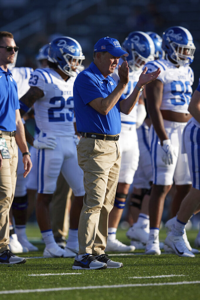 Duke coach David Cutcliffe encourages players as they warm up for an NCAA college football game against Charlotte on Friday, Sept. 3, 2021, in Charlotte, N.C. (AP Photo/Brian Westerholt)