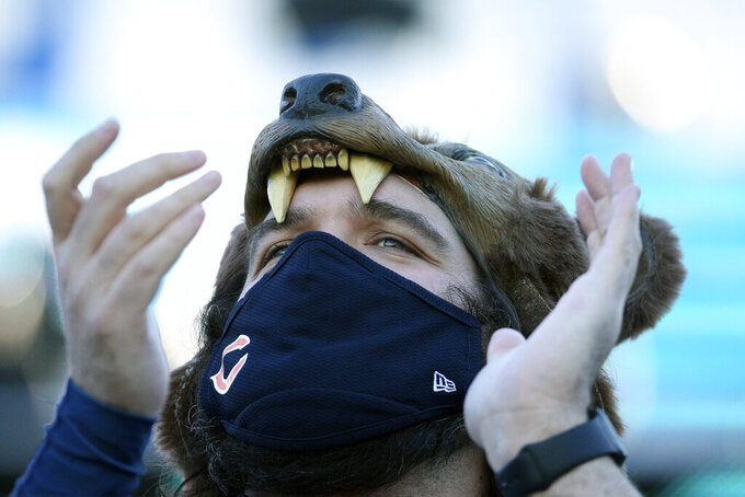 A Chicago Bears fan cheers during the second half of an NFL football game between the Jacksonville Jaguars and the Chicago Bears, Sunday, Dec. 27, 2020, in Jacksonville, Fla. (AP Photo/Stephen B. Morton)