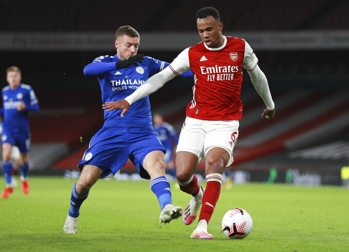 Leicester's Jamie Vardy, left, tackles Arsenal's Gabriel during the English Premier League soccer match between Arsenal and Leicester City at Emirates Stadium in London, England, Sunday, Oct. 25, 2020. (AP Photo/Ian Walton,Pool)