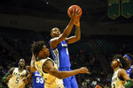 Memphis forward D.J. Jeffries (0) puts up a shot over UAB forward Will Butler (12) during the second half of an NCAA college basketball game Saturday, Dec. 7, 2019, in Birmingham, Ala. (AP Photo/Butch Dill)