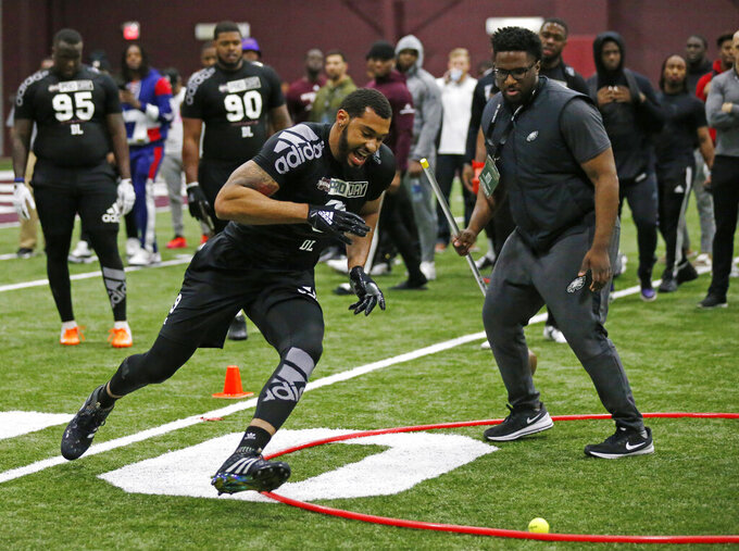 Former Mississippi State defensive player Montez Sweat runs an agility drill while getting combine tested by NFL football scouts and coaches during Pro Day at Mississippi State, Wednesday, March 27, 2019, in Starkville, Miss. (AP Photo/Rogelio V. Solis)