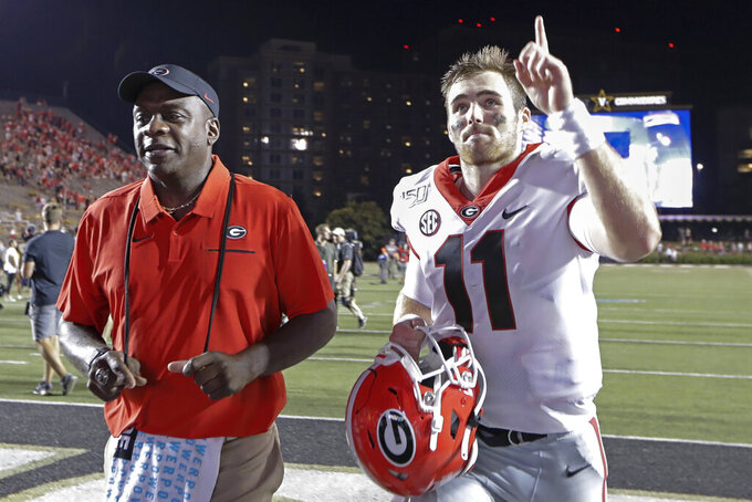 Georgia quarterback Jake Fromm (11) gestures to fans as he leaves the field after an NCAA college football game against Vanderbilt, Saturday, Aug. 31, 2019, in Nashville, Tenn. (AP Photo/Mark Humphrey)