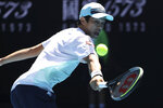 United States' Mackenzie McDonald hits a backhand to Russia's Daniil Medvedev during their fourth round match at the Australian Open tennis championships in Melbourne, Australia, Monday, Feb. 15, 2021. (AP Photo/Hamish Blair)