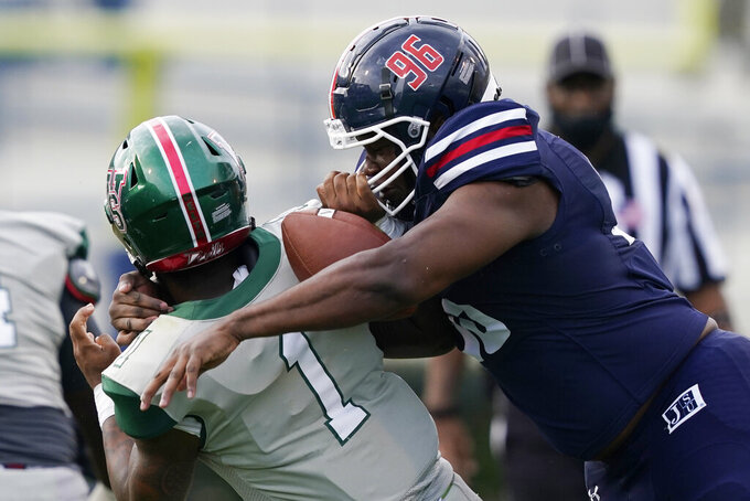 Jackson State defensive lineman Jaumonie Crain forces Mississippi Valley State quarterback Jalani Eason (1) to fumble during the second half of an NCAA college football game, Sunday, March 14, 2021, in Jackson, Miss. (AP Photo/Rogelio V. Solis)