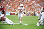 Texas quarterback Sam Ehlinger (11) scrambles for a 9-yard touchdown against Oklahoma during the first half of an NCAA college football game at the Cotton Bowl, Saturday, Oct. 6, 2018, in Dallas. (AP Photo/Cooper Neill)