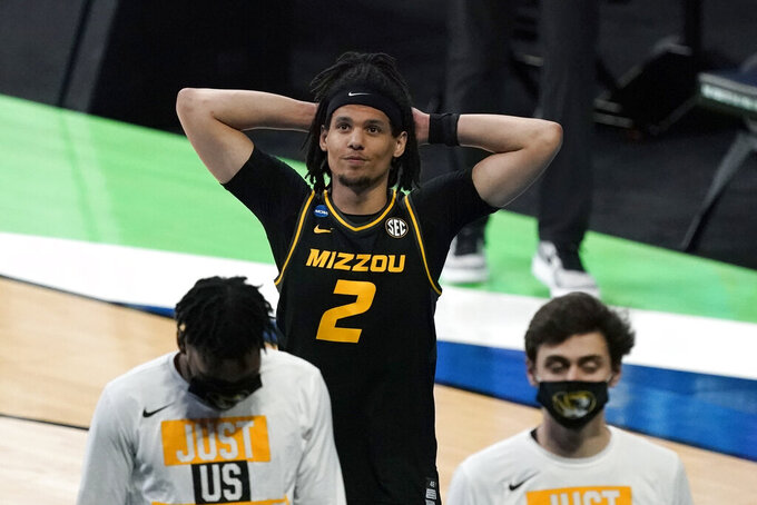 Missouri guard Drew Buggs (2) walks off the court after a first-round game against Oklahoma in the NCAA men's college basketball tournament at Lucas Oil Stadium, Saturday, March 20, 2021, in Indianapolis. Oklahoma won 72-68. (AP Photo/Darron Cummings)