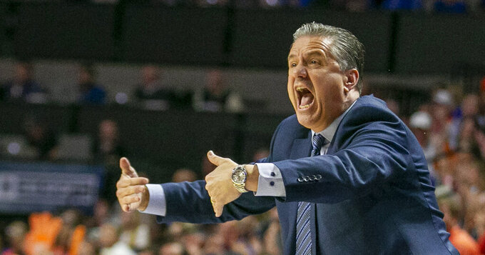 FILE - Kentucky head coach John Calipari screams at players after Florida scored during the first half of an NCAA college basketball game in Gainesville, Fla., in this Saturday, March 7, 2020, file photo. The No. 10 Wildcats lost five starters among nine departures from last season including Southeastern Conference Player of the Year Immanuel Quickley and All-SEC first teamer Nick Richards. Of course, being Kentucky, expectations of another national championship remain high. (AP Photo/Alan Youngblood, File)