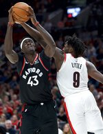 Toronto Raptors forward Pascal Siakam, left, shoots over Portland Trail Blazers forward Nassir Little during the second half of an NBA basketball game in Portland, Ore., Wednesday, Nov. 13, 2019. (AP Photo/Craig Mitchelldyer)