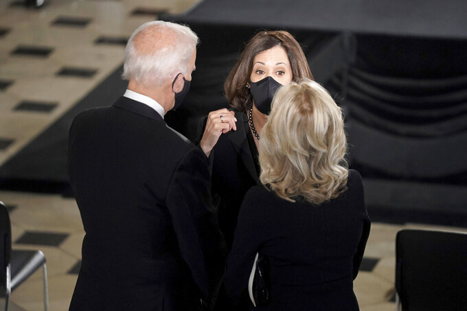 Democratic presidential candidate former Vice President Joe Biden and his wife Jill talk with Democratic vice presidential candidate Sen. Kamala Harris, D-Calif., before a ceremony to honor Justice Ruth Bader Ginsburg as she lies in state at National Statuary Hall in the U.S. Capitol on Friday, Sept. 25, 2020. Ginsburg died at the age of 87 on Sept. 18 and is the first women to lie in state at the Capitol. (Greg Nash/Pool via AP)