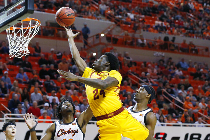 Iowa State guard Terrence Lewis (24) shoots in front of Oklahoma State forward Kalib Boone, left, and forward Cameron McGriff, right, in the second half of an NCAA college basketball game in Stillwater, Okla., Saturday, Feb. 29, 2020. (AP Photo/Sue Ogrocki)