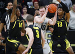 Colorado forward Alexander Strating, back center, is trapped with the ball by Oregon forwards C.J. Walker, back left, and Chandler Lawson, back right, and guard Payton Pritchard in the first half of an NCAA college basketball game Thursday, Jan. 2, 2020, in Boulder, Colo. (AP Photo/David Zalubowski)