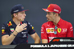 Red Bull driver Max Verstappen of the Netherlands and Ferrari driver Charles Leclerc of Monaco look at each other during a press conference for the Japanese Formula One Grand Prix at Suzuka Circuit in Suzuka, Thursday, Oct. 10, 2019. (AP Photo/Toru Hanai)