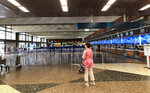 Few people are in the departure lobby at Honolulu's Daniel K. Inouye International Airport on Thursday, March 26, 2020, as Hawaii imposed a 14-day traveler quarantine to slow the coronavirus. Travelers landed in Hawaii to a new requirement that they hole up in hotel rooms or their homes for 14 days to fight the spread of the virus. (AP Photo/Audrey McAvoy)
