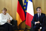 French President Emmanuel Macron, right, and German Chancellor Angela Merkel meet on the sidelines of an EU summit in Brussels, Thursday, June 20, 2019. European Union leaders meet for a two-day summit to begin the process of finalizing candidates for the bloc's top jobs. (Kenzo Tribouillard, Pool Photo via AP)