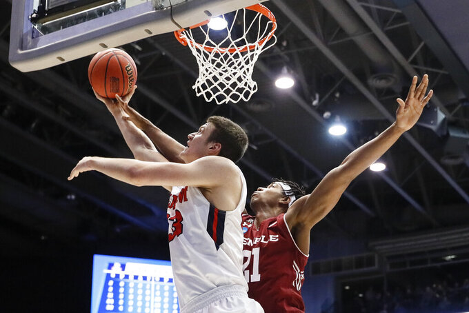 Belmont's Nick Muszynski (33) shoots against Temple's Justyn Hamilton (21) during the first half of a First Four game of the NCAA college basketball tournament, Tuesday, March 19, 2019, in Dayton, Ohio. (AP Photo/John Minchillo)