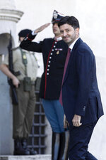 Roberto Speranza, center, Health Minister, arrives for a swearing-in ceremony at the Quirinale Presidential Palace, in Rome, Thursday, Sept. 5, 2019. Italian Premier Giuseppe Conte forged a new coalition government Wednesday that teams up the populist 5-Star Movement and center-left Democrats in an unusual alliance of rivals to banish for now the specter of early election that likely could have seen the triumph of Italy's fast-rising right-wing forces. (Massimo Percossi/ANSA via AP)