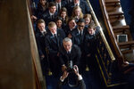 NATO Secretary General Jens Stoltenberg, center, poses with pages as he departs after addressing a Joint Meeting of Congress on Capitol Hill in Washington, Wednesday, April 3, 2019, having been invited by the bipartisan leadership of the House of Representatives and the Senate. (AP Photo/Andrew Harnik)