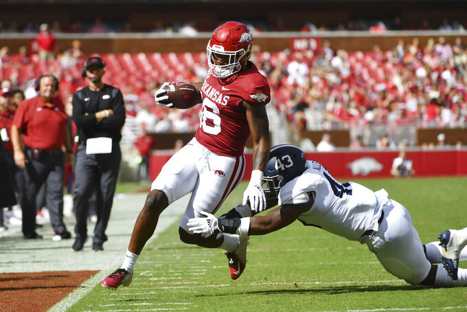 Arkansas receiver Treylon Burks (16) is knocked out of bounds by Georgia Southern defender Tre Allen (43) during the first half of an NCAA college football game Saturday, Sept. 18, 2021, in Fayetteville, Ark. (AP Photo/Michael Woods)