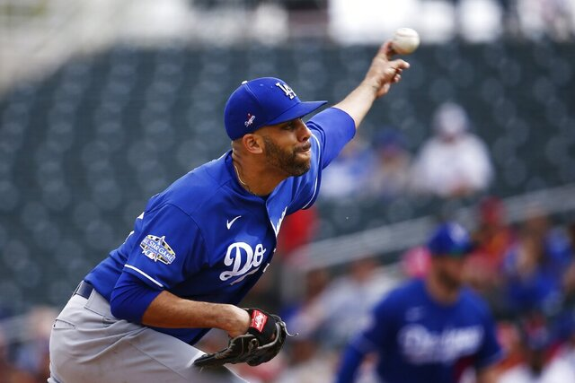FILE - In this March 2, 2020, file photo, Los Angeles Dodgers starting pitcher David Price throws against the Cincinnati Reds during the first inning of a spring training baseball game in Goodyear, Ariz. Price will not play this season because of concerns over the coronavirus pandemic, delaying his Los Angeles debut until next year. The five-time All-Star became the latest player to opt out, posting Saturday, July 4, 2020, on Twitter that he would not participate in the 60-game season that is scheduled to begin July 23. (AP Photo/Ross D. Franklin, File)