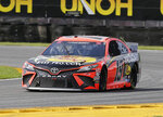 Martin Truex Jr. drives through Turn 3 during a NASCAR Cup Series auto race at Daytona International Speedway, Sunday, Aug. 16, 2020, in Daytona Beach, Fla. (AP Photo/Terry Renna)