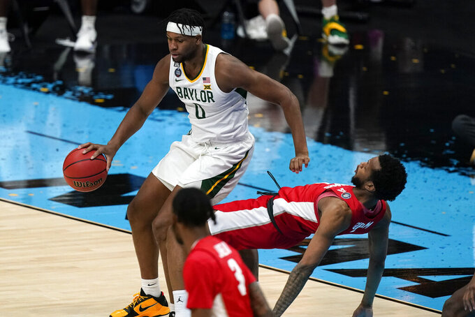 Baylor forward Flo Thamba (0) drives past Houston forward Justin Gorham, right, during the second half of a men's Final Four NCAA college basketball tournament semifinal game, Saturday, April 3, 2021, at Lucas Oil Stadium in Indianapolis. (AP Photo/Michael Conroy)