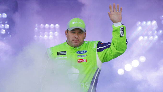 Ryan Newman waves to fans during driver introductions prior to the start of the NASCAR Cup series auto race at Richmond Raceway in Richmond, Va., Saturday, April 13, 2019. (AP Photo/Steve Helber)