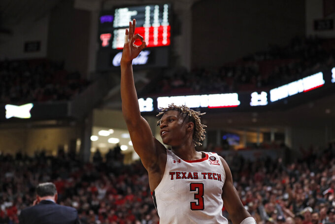 Texas Tech's Jahmi'us Ramsey (3) celebrates after scoring a three-point basket during the first half of an NCAA college basketball game against TCU, Monday, Feb. 10, 2020, in Lubbock, Texas. (AP Photo/Brad Tollefson)
