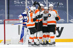 Philadelphia Flyers' Jakub Voracek, center, celebrates with teammates Travis Konecny (11), Robert Hagg (8) and Shayne Gostisbehere (53) after scoring a goal during the second period of an NHL hockey game against the New York Islanders Thursday, April 8, 2021, in Uniondale, N.Y. (AP Photo/Frank Franklin II)