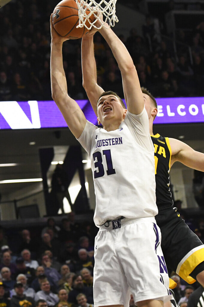 Northwestern forward Robbie Beran (31) has his shot blocked by Iowa guard Joe Wieskamp during the second half of an NCAA college basketball game Tuesday, Jan. 14, 2020, in Evanston, Ill. (AP Photo/David Banks)