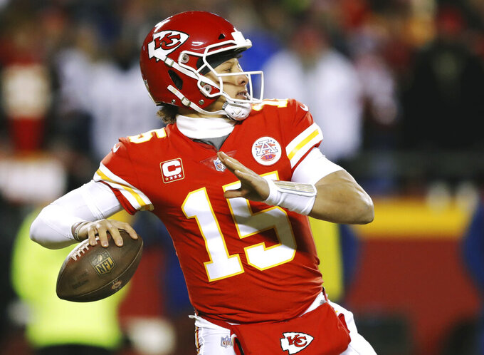 Kansas City Chiefs quarterback Patrick Mahomes throws a pass during the first half of the AFC Championship NFL football game against the New England Patriots, Sunday, Jan. 20, 2019, in Kansas City, Mo. (AP Photo/Charlie Neibergall)