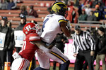 Michigan wide receiver Nico Collins, right, pulls in a touchdown catch on a pass from quarterback Shea Patterson as Rutgers defensive back Avery Young (20) tries to stop him during the second half of an NCAA college football game, Saturday, Nov. 10, 2018, in Piscataway, N.J. (AP Photo/Julio Cortez)