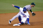 Los Angeles Dodgers' Joc Pederson, bottom, is out at second base next to Oakland Athletics shortstop Marcus Semien on a ground ball from Chris Taylor during the second inning of a baseball game Thursday, Sept. 24, 2020, in Los Angeles. Taylor was safe at first. (AP Photo/Marcio Jose Sanchez)