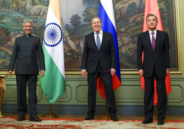 ICAPTION CORRECTS DATE In this photo released by the Russian Foreign Ministry Press Service, India's Foreign Minister S. Jaishankar, left, Russia's Foreign Minister Sergey Lavrov, and China's Foreign Minister Wang Yi, pose for a photo on the sidelines of a meeting of Foreign Ministers of Shanghai Cooperation Organisation, Commonwealth of Independent States and Collective Security Treaty Organization Member States in Moscow, Russia, Thursday, Sept. 10. 2020. (Russian Foreign Ministry Press Service via AP)