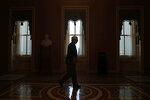 FILE - In this April 9, 2020, file photo Senate Majority Leader Mitch McConnell of Ky., walks to the Senate chamber on Capitol Hill in Washington. The Senate is set to resume Monday, May 4. (AP Photo/Patrick Semansky, File)