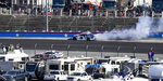 Chase Elliott (9) slides into the wall while exiting Turn 2 during a NASCAR Cup Series auto race at Texas Motor Speedway, Sunday, Nov. 3, 2019, in Fort Worth, Texas. (AP Photo/Larry Papke)