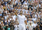 Serbia's Novak Djokovic celebrates defeating Switzerland's Roger Federer in the men's singles final match of the Wimbledon Tennis Championships in London, Sunday, July 14, 2019. (AP Photo/Kirsty Wigglesworth)