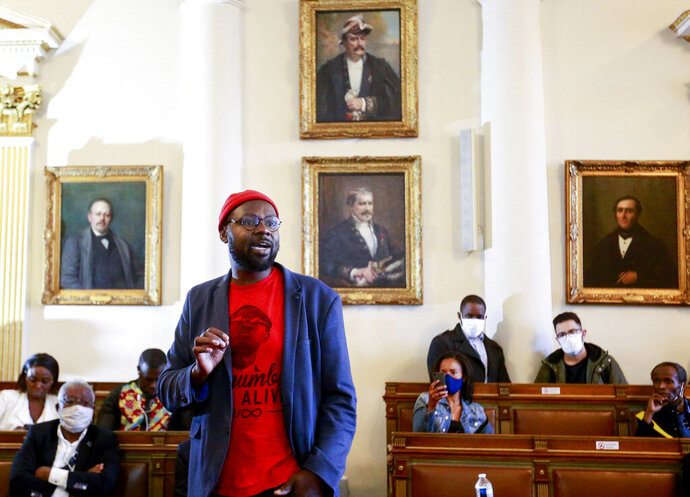 Congolese-Belgian artist Pitcho speaks during celebrations marking the 60th anniversary of Congo's independence from Belgium in the Brussels district of Matonge, Tuesday, June 30, 2020. (Stephanie Lecocq, Pool Photo via AP)