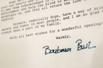 This Wednesday, Jan. 9, 2019, photo shows a detail of the letter former first lady Barbara Bush wrote to the American Kennel Club Museum of the Dog on the occasion of it's opening in 1990, on display in New York. The collection features paintings of White House dogs: U.S. President George W. Bush's Scottish terriers, Barney and Miss Beazley, and one of President George H.W. Bush's English springer spaniels, Millie. (AP Photo/Mary Altaffer)
