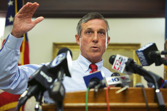 FILE - In this Friday, Sept. 1, 2017, file photo, Gov. John Carney speaks at a news conference in Wilmington, Del. Delaware's attorney general is investigating the medical contractor for the state's prison system amid allegations that contract counselors were ordered to forge documents to indicate that inmates were getting mental health treatment they never received.