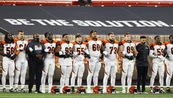 The Cincinnati Bengals line up arm-in arm before an NFL football game against the Cleveland Browns, Thursday, Sept. 17, 2020, in Cleveland. (AP Photo/Ron Schwane)