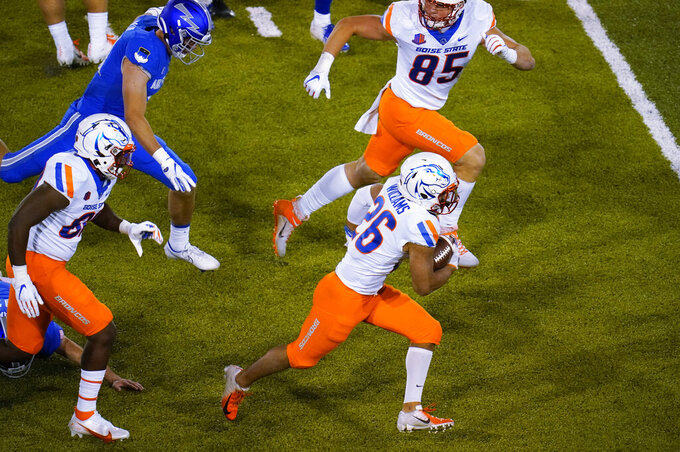 Boise State's Avery Williams heads down the field for a touchdown after fielding a kickoff during the second half against Air Force in an NCAA college football game Saturday, Oct. 31, 2020, at Air Force Academy, Colo. (AP Photo/David Zalubowski)