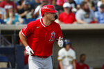 Los Angeles Angels' Mike Trout heads to first base with a walk in the first Inning of a spring training baseball game against the Milwaukee Brewers, Sunday, March 8, 2020, in Phoenix, Ariz. (AP Photo/Sue Ogrocki)