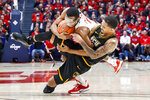 Dayton's Rodney Chatman, above, and Virginia Commonwealth's Marcus Evans, right, tangle up during the first half of an NCAA college basketball game, Tuesday, Jan. 14, 2020, in Dayton, Ohio. (AP Photo/John Minchillo)