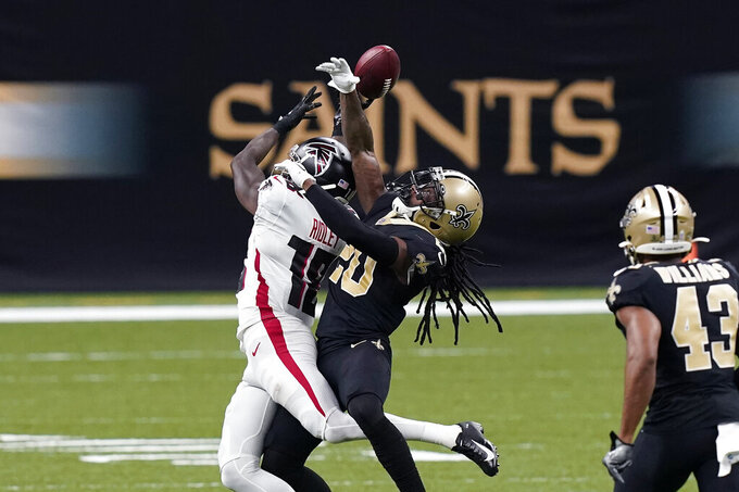 New Orleans Saints cornerback Janoris Jenkins (20) breaks up a pass intended for Atlanta Falcons wide receiver Calvin Ridley (18) in the second half of an NFL football game in New Orleans, Sunday, Nov. 22, 2020. (AP Photo/Butch Dill)