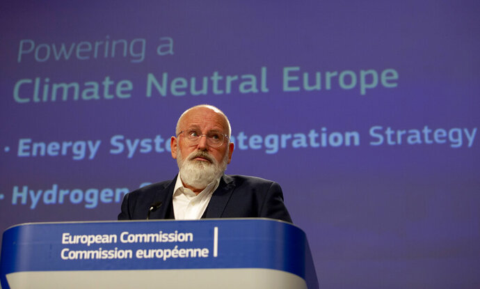 European Commissioner for European Green Deal Frans Timmermans speaks during a media conference at EU headquarters in Brussels, Wednesday, July 8, 2020. The EU wants to promote hydrogen produced from renewable electricity as part of its Green Deal plan to make the continent carbon neutral by 2050. (AP Photo/Virginia Mayo, Pool)