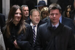 Harvey Weinstein, center, is surrounded by his attorneys Donna Rotunno, left, and Damon Cheronis, as he leaves court for the day in his rape trial, Thursday, Feb. 13, 2020, in New York. (AP Photo/Mary Altaffer)